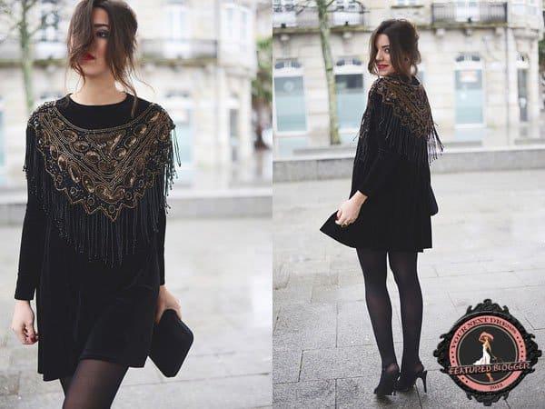 Carla wears an Armani Exchange velvet dress