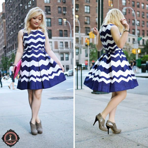 Tineey wears a full-skirt chevron print dress with neutral patent shoes