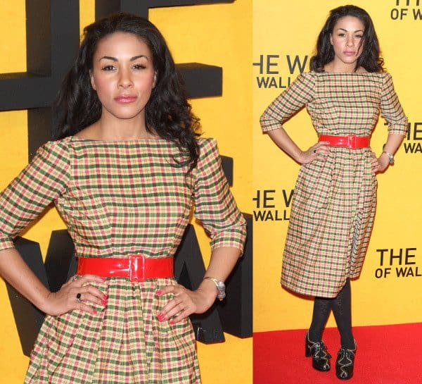 Actress Kathryn Drysdale in a black-and-yellow plaid dress and cutout heeled Oxfords at the premiere of The Wolf of Wall Street at the Odeon Leicester Square in London, England, on January 9, 2014