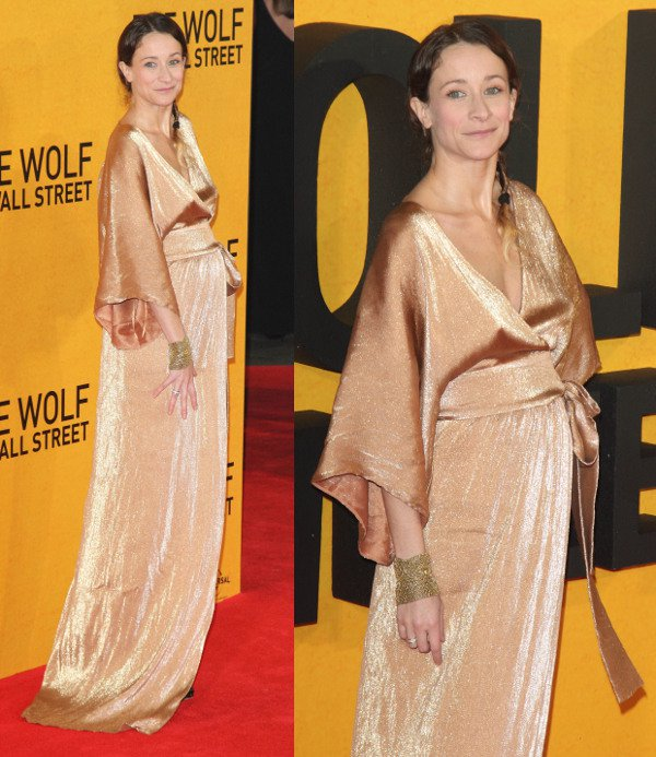 Leah Wood in a gold kaftan-style ensemble at The Wolf of Wall Street premiere at the Odeon Leicester Square in London, England, on January 9, 2014
