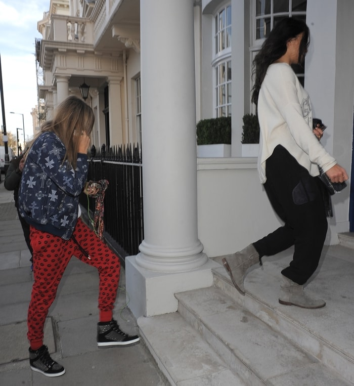 Hot Lesbian Couple: Cara Delevingne and her girlfriend Michelle Rodriguez arrive home in London
