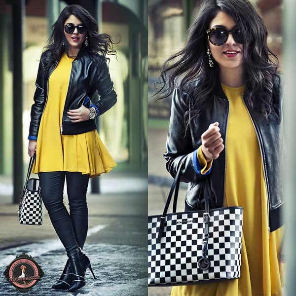 Zipy rocks a bright yellow dress with a leather jacket and a checkered handbag