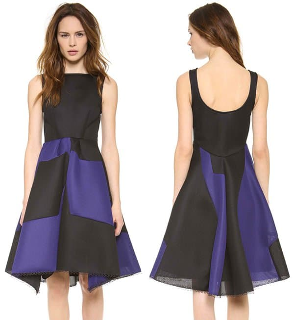 An eclectic, laser-cut neoprene black/blue dress makes a mod impression with bold two-tone detailing