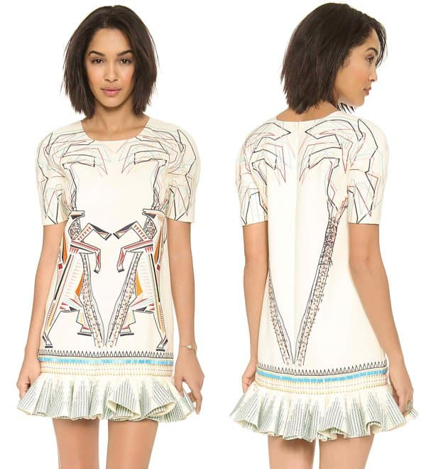 Playful patterns rendered in colorful embroidery lend a cheery feel to a silk-crepe ivory dress
