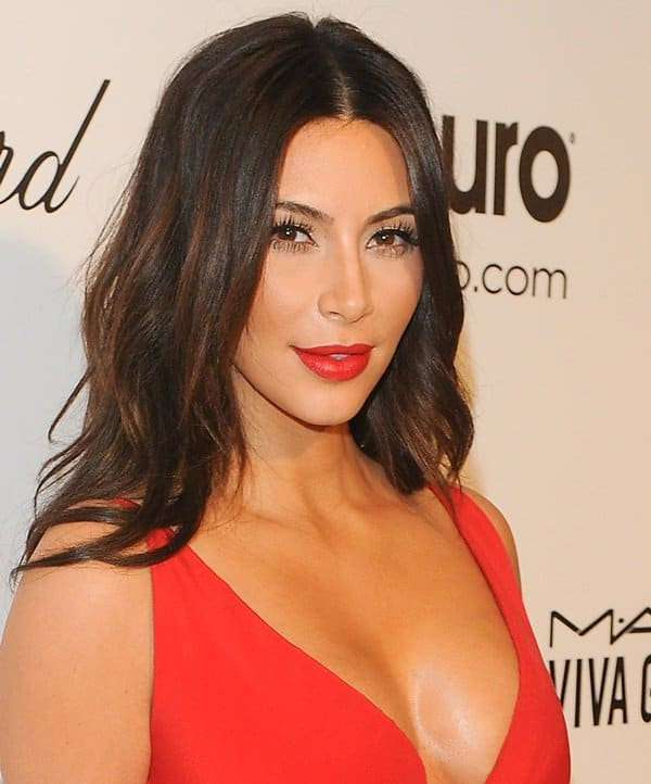Kim Kardashian flashed her cleavage in a red empire-waist dress