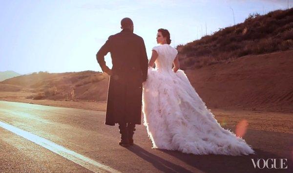 Kim Kardashian in a white feathered Alexander McQueen gown