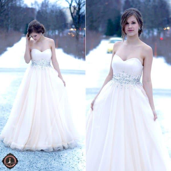 Linda wears an off-white Disney dress