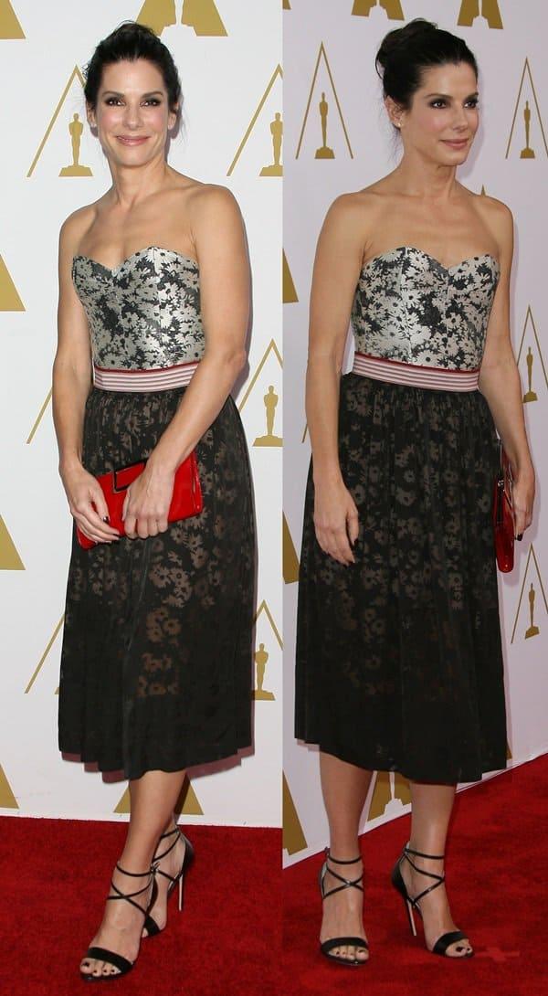 Sandra Bullock styled her strapless Stella McCartney dress with black sandals