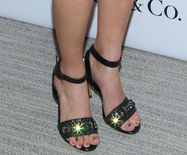 AnnaSophia Robb in metallic sandals