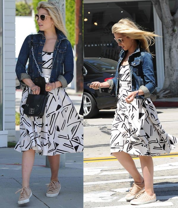 Dianna Agron wears a denim jacket with a flared dress