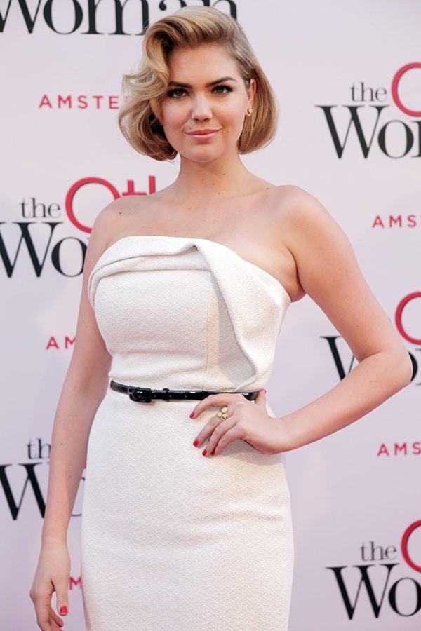 Kate Upton's white sculptural, strapless Christian Siriano dress