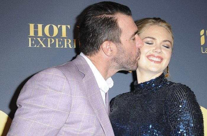 Justin Verlander kisses his wife Kate Upton at the Maxim Hot 100 Experience