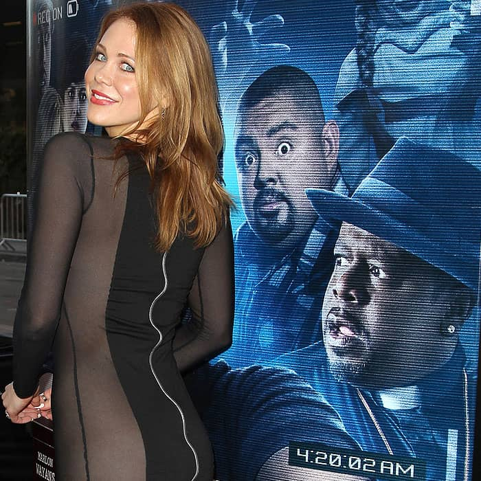 Interesting angles of Maitland Ward and the 'A Haunted House 2' movie poster