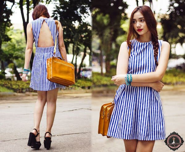 Aileen wears a beautiful striped dress with wedge sandals