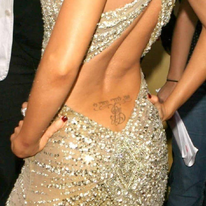 Christina Aguilera exposing her Hebrew psalm lyric tattoo