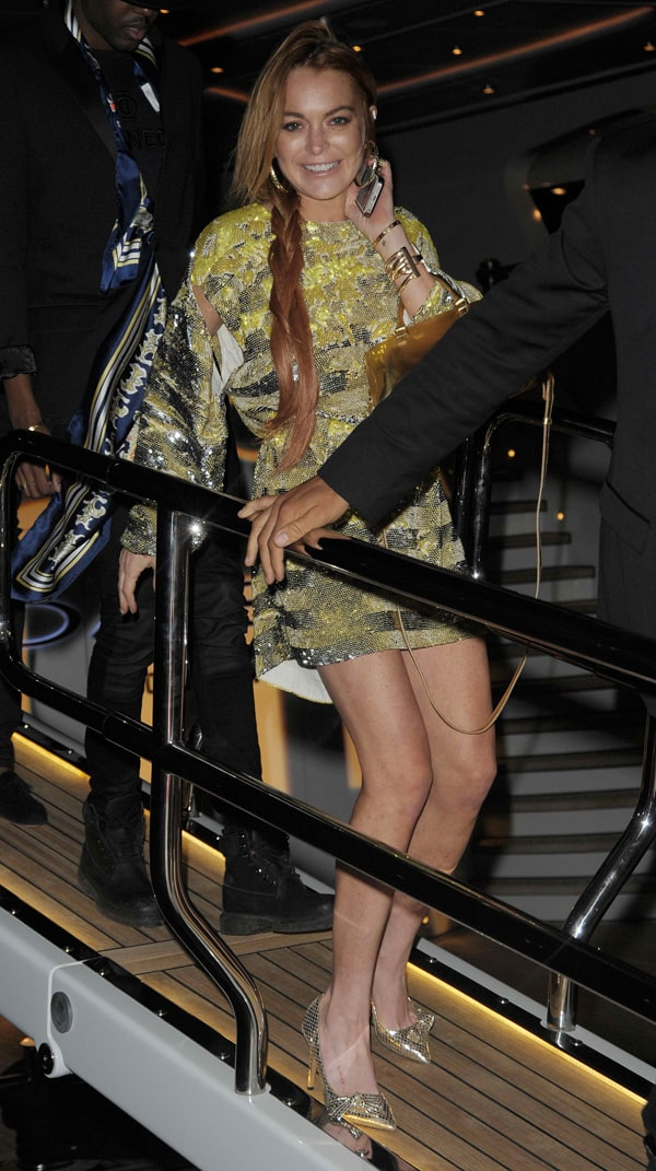 16ff450fc51c Lindsay Lohan Parties in a Gold Sequined Dress — This May Be the Prettiest  We've Seen Her in a While!