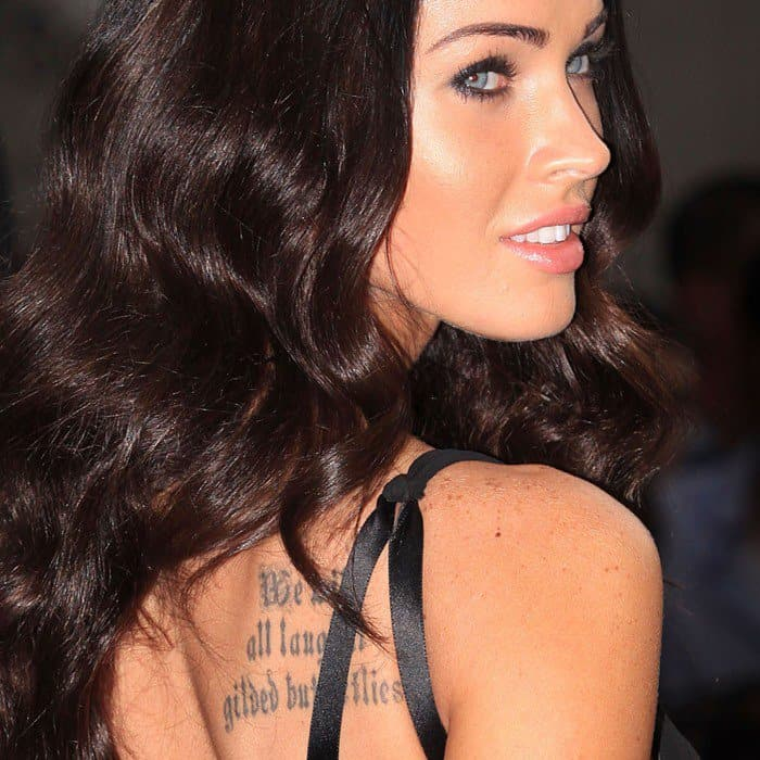 Megan Fox showing off her back quote tat from King Lear