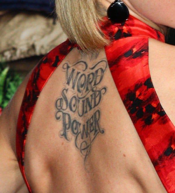Mena Suvari showing off her tattoo