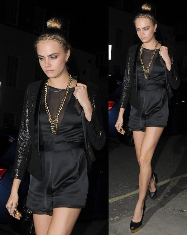 Cara Delevigne in Kate Moss for Topshop's satin romper at the launch in London, England, on April 29, 2014