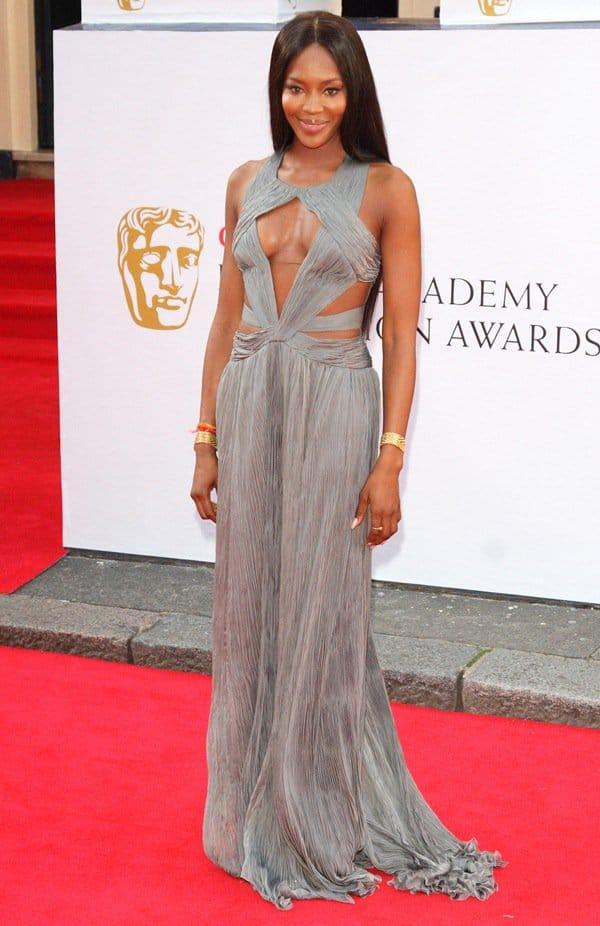 Naomi Campbell a gunmetal floor-length Roberto Cavalli dress at the Arqiva BAFTA Television Awards