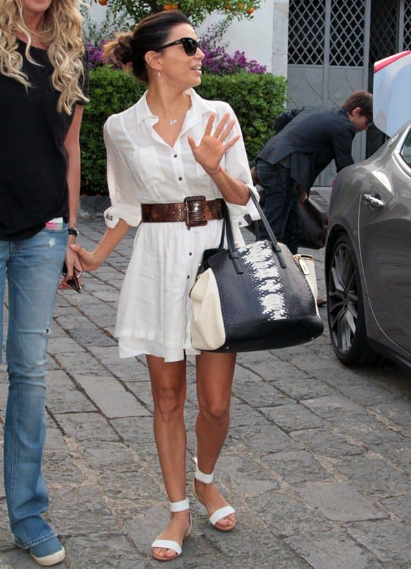 Eva Longoria beat the Italian heat in a comfy white shirtdress that she styled with a thick python leather belt