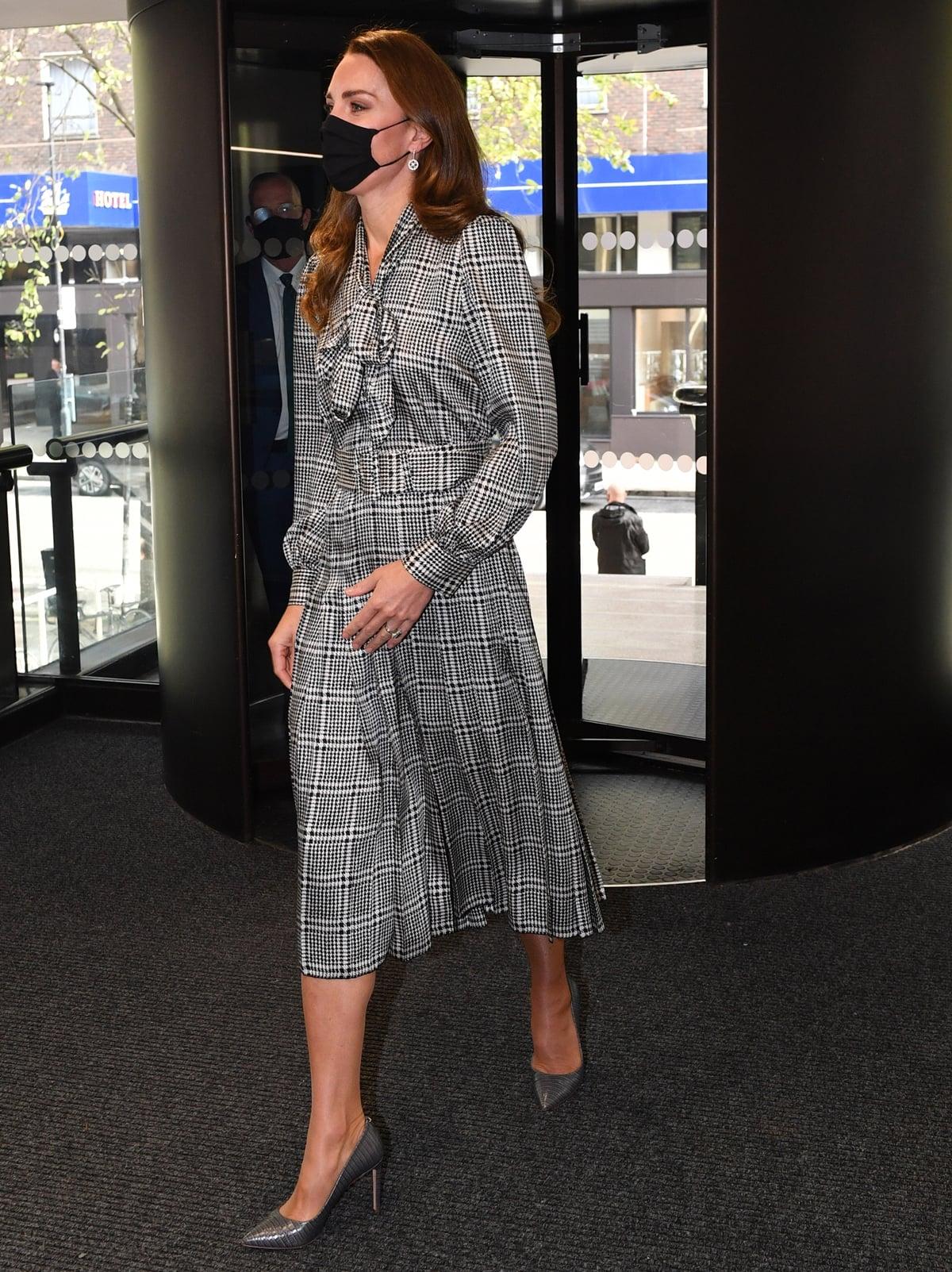Kate Middleton wears a belted Zara printed dress with Hugo Boss high heels