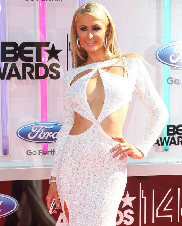 Paris Hilton in a sparkling white Michael Costello sequined dress