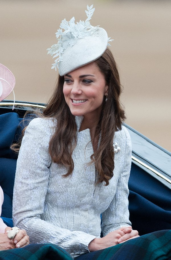 Catherine, Duchess of Cambridge, in a blue jacquard silk blazer and skirt by Alexander McQueen