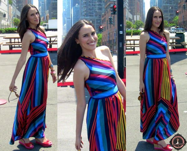 Mercedes styled her multicolored maxi dress with red shoes