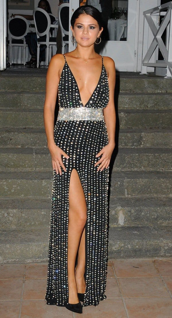 Selena Gomez accepted the Kids Global Icon award in a gorgeous bejeweled number that displayed her cleavage, back, and legs