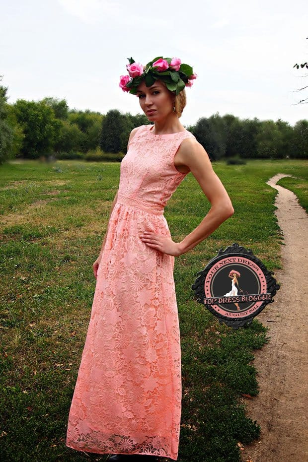 Marina wears one of the loveliest pink lace dresses ever