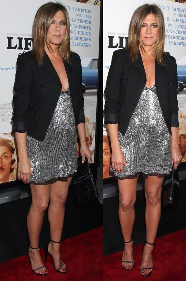 Jennifer Aniston ina silver sequin mini dress from Saint Laurent