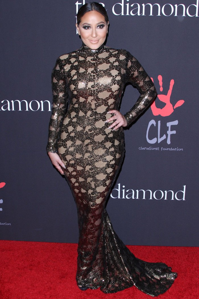 Adrienne did not do her amazing figure justice with the sequined dress she wore
