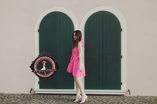 Francesca teams her feminine pink dress with blush pink slingback pumps