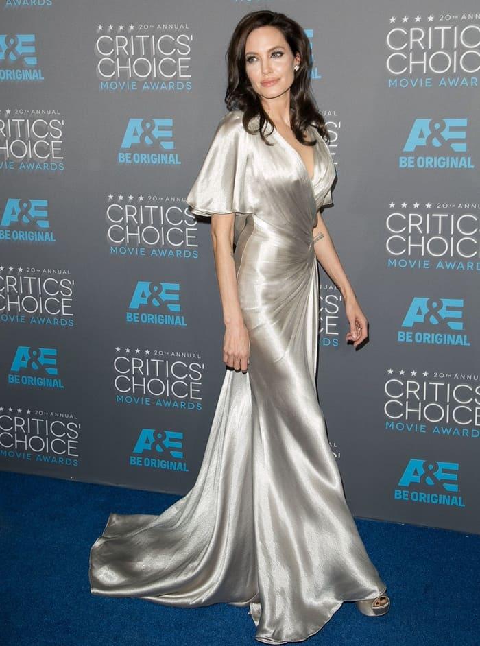 Angelina Jolie donned a metallic silk dress from Atelier Versace