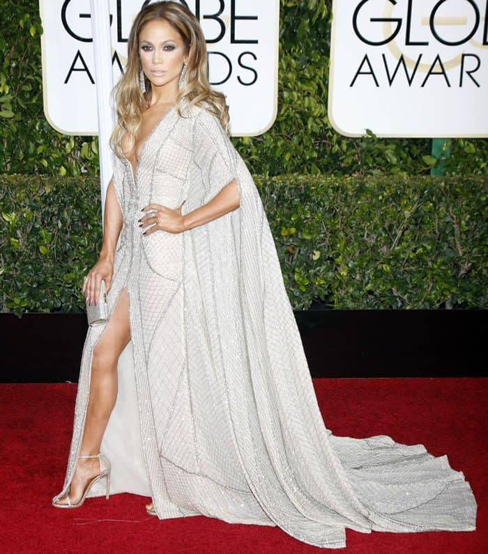 "Jennifer Lopez in a sexy gown from the Zuhair Murad Fall 2014 Couture collection styled with a ""Mini Tube"" clutch from Jimmy Choo"