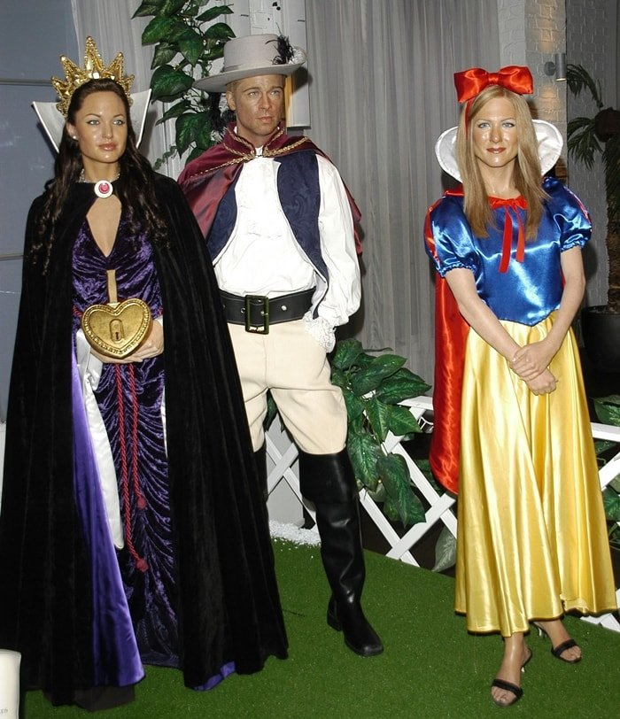 Popular tourist attraction Madame Tussauds unveils its seasonal waxwork scene, featuring models of (L-R) Angelina Jolie as the Wicked Stepmother, Brad Pit as Prince Charming from Snow White, and Jennifer Aniston as Snow White