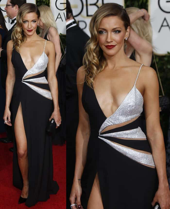 Katie Cassidy in a slashed silver and black gown that showed a lot of cleavage