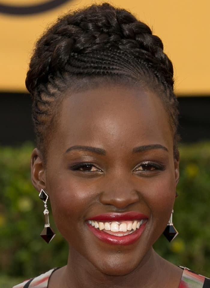 Lupita Nyong'o shows off her sexy lips and Art-Deco-inspired Fred Leighton earrings