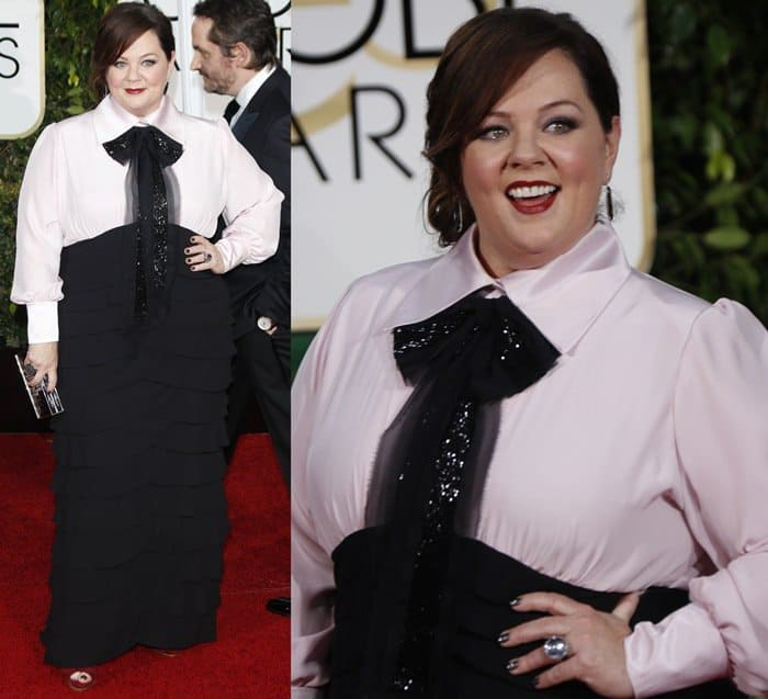 Melissa McCarthy in self-designed masculine black and white gown featuring an oversized bow