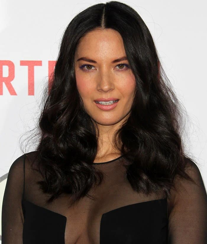 Olivia Munn's tousled hairstyle and sheer-effect gown