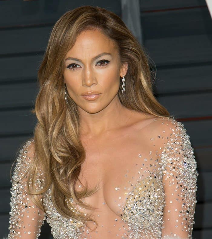 Jennifer Lopez flaunts cleavage in a naked see-through dress