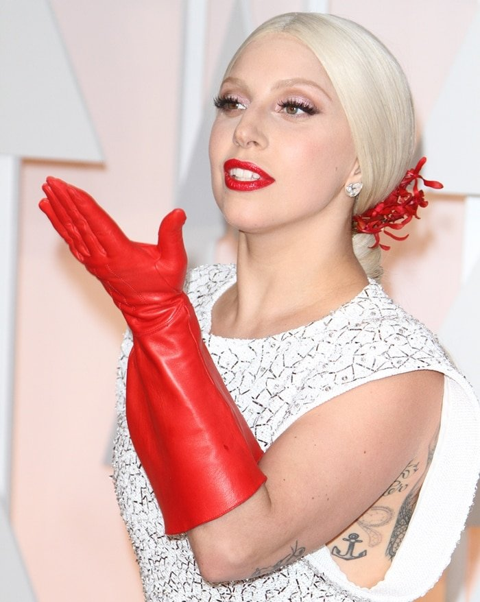Lady Gaga's elbow-length red leather dishwasher gloves