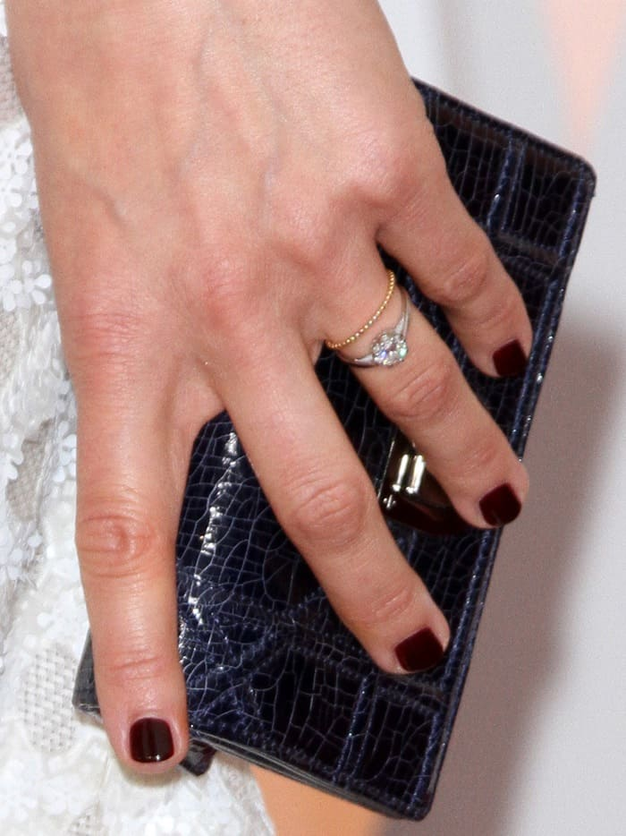 Marion Cotillard shows off her rings and clutch bag on the red carpet