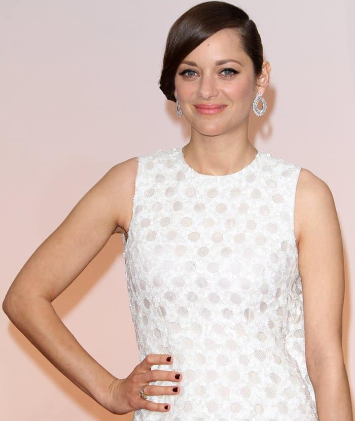 Marion Cotillard in a white Christian Dior dress at the 2015 Academy Awards