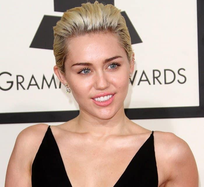 Dolly Parton's goddaughter Miley Cyrus shows off her Lorraine Schwartz jewelry
