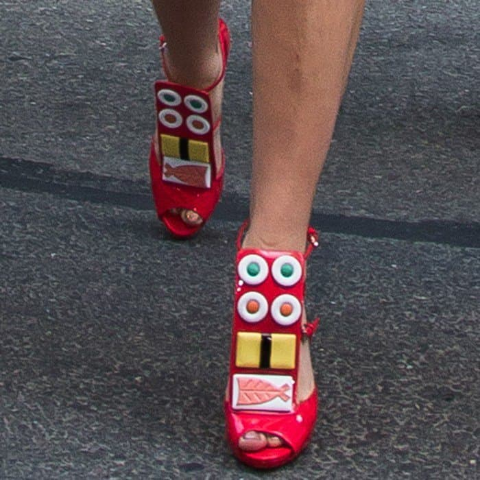 Lady Gaga wearingsushi-adorned platform shoes