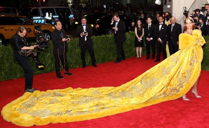 Rihanna did not disappoint in a spectacularly elaborate couture number by Chinese designer Guo Pei featuring a long cape-style coat