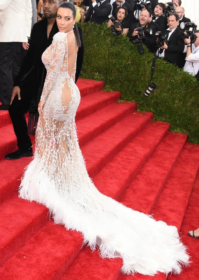 Kim wore a stunning sheer white gown designed by Peter Dundas for Roberto Cavalli