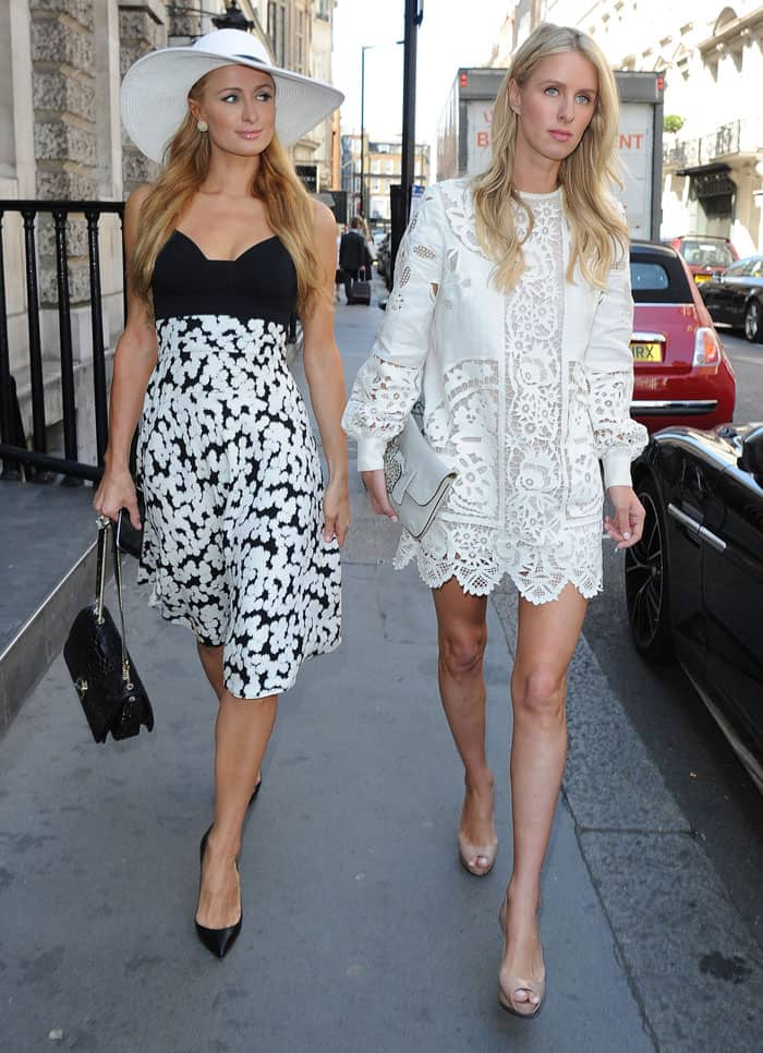 Paris Hilton enjoys lunch at The Arts Club in Mayfair, with sister Nicky Hilton